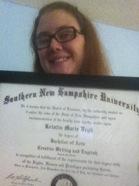 Kay graduating Summa Cum Laude, 2013.